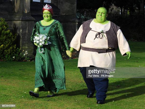 Nathan Gibbs and Amanda Billington after getting married dressed as Shrek and Princess Fiona at Priory Hall Dudley West Midlands in aid of Cancer...