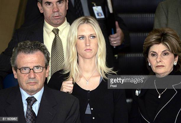 Nathan Goldberg Amber Frey and Gloria Allred leave the San Mateo County Courthouse on August 12 2004 in Redwood City California Scott Peterson could...