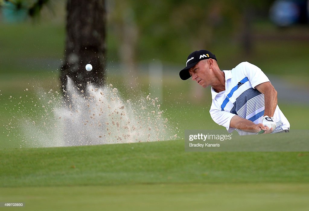 Nathan Green of Australia plays a shot out of the bunker on the 7th hole during day one of the 2015 Australian PGA Championship at Royal Pines Resort on December 3, 2015 in Gold Coast, Australia.