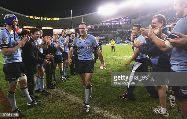 Nathan Grey of the Waratahs is clapped from the field by team mates during the Super 12 semi final match between the New South Wales Waratahs and the...