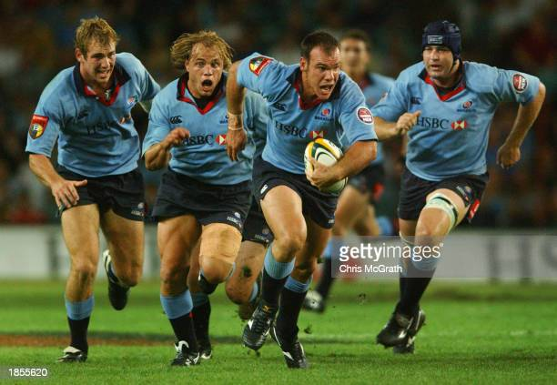 Nathan Grey of the Waratahs makes a break during the round four Super 12's match between the New South Wales Waratahs and the Bulls played at Aussie...