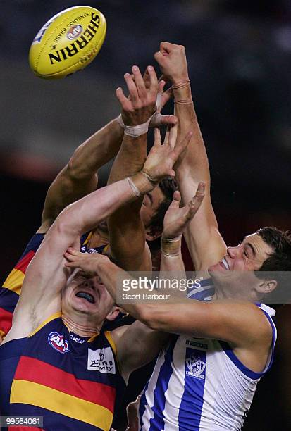Nathan Grima of the Kangaroos and Patrick Dangerfield of the Crows compete for the ball during the round eight AFL match between the North Melbourne...