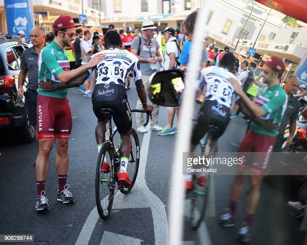 Nathan Haas of Australia and Team Katusha Alpecin congratulates Nicholas Dlamini of South Africa and Team Dimension Data prior to stage three of the...
