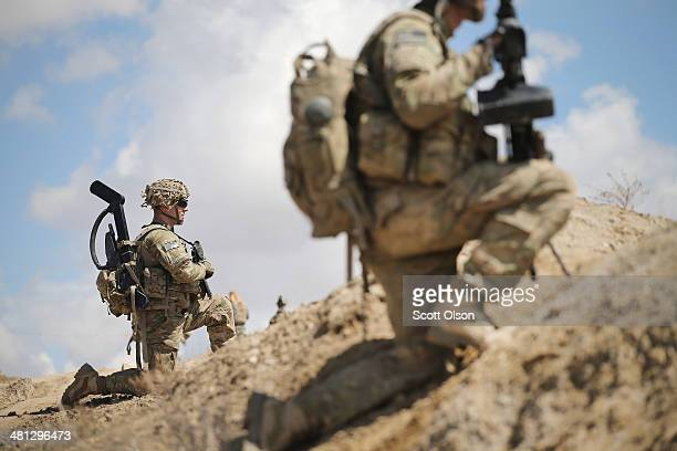 Nathan Harrell from Peru New York with the US Army's 2nd Battalion 87th Infantry Regiment 3rd Brigade Combat Team 10th Mountain Division patrols on...