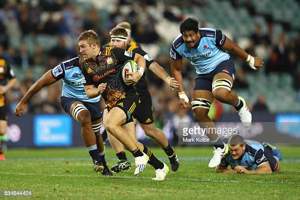 Nathan Harris of the Chiefs makes a break during the round 14 Super Rugby match between the Waratahs and the Chiefs at Allianz Stadium on May 27 2016...
