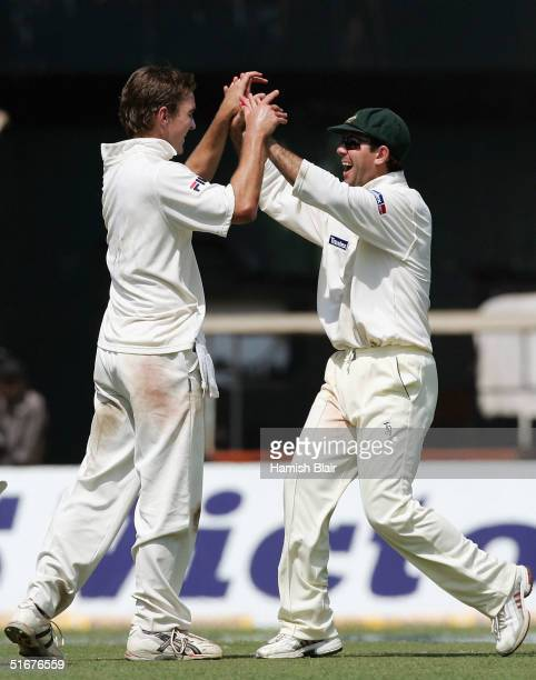 Nathan Hauritz of Australia celebrates the wicket of VVS Laxman of India with team mate Ricky Ponting during day three of the Fourth Test between...