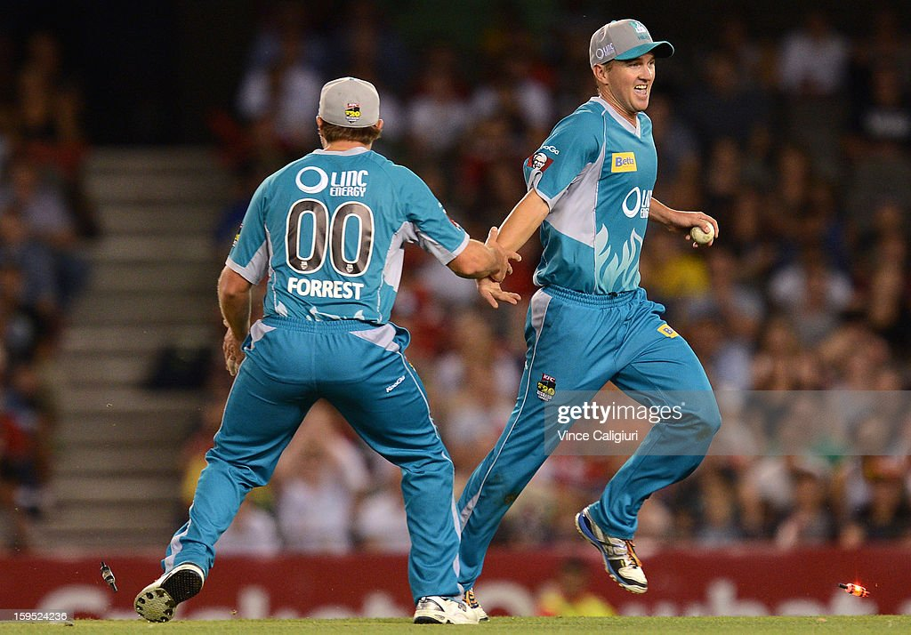 Nathan Hauritz of the Heat celebrates with Peter Forrest after dismissing Peter Nevill during the Big Bash League Semi-Final match between the Melbourne Renegades and the Brisbane Heat at Etihad Stadium on January 15, 2013 in Melbourne, Australia.