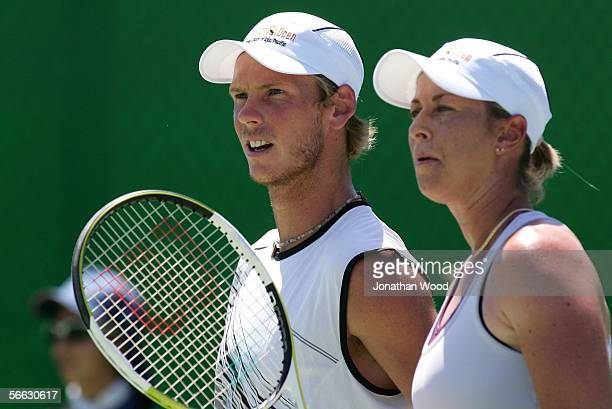 Nathan Healey of Australia and Trudi Musgrave of Australia talks tactics in their doubles match against Jim Thomas of the USA and Bryanne Stewart of...