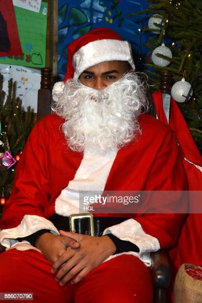 Nathan Henry attends a Christmas Photocall in Santa's Grotto at Leicester Square on December 5 2017 in London England