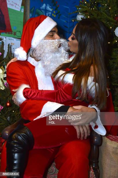 Nathan Henry Sophie Kasaei attends a Christmas Photocall in Santa's Grotto at Leicester Square on December 5 2017 in London England