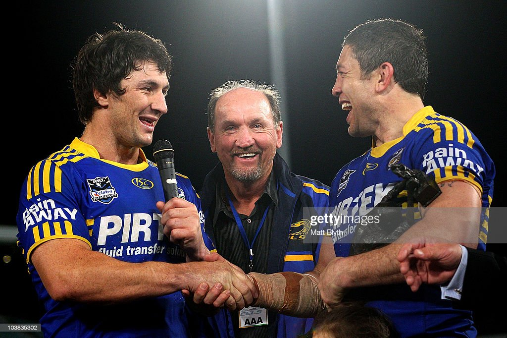 Nathan Hindmarsh and former Eels great Ray Price congratulate Nathan Cayless of the Eels after playing his last match after the round 26 NRL match between the Parramatta Eels and the Warriors at Parramatta Stadium on September 4, 2010 in Sydney, Australia.