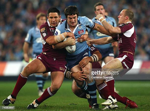 Nathan Hindmarsh of the Blues is tackled by Steve Price and Darren Lockyer of the Maroons during game two of the ARL State of Origin series between...