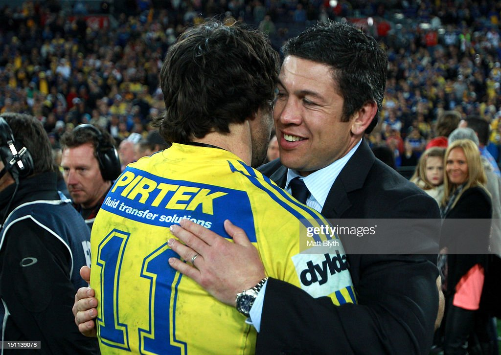 Nathan Hindmarsh #11 of the Eels is congratulated by former Eels player Nathan Cayless after playing in his final NRL match after the round 26 NRL match between the Parramatta Eels and the St George Illawarra Dragons at ANZ Stadium on September 2, 2012 in Sydney, Australia.