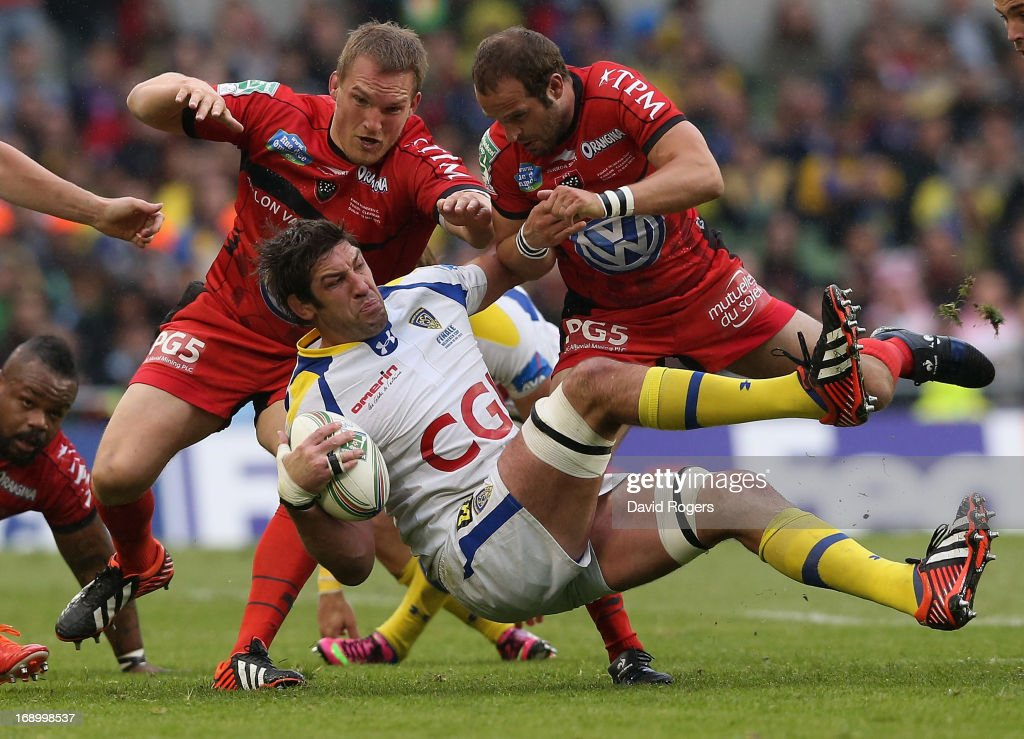 Nathan Hines of Clermont is tackled by Gethin Jenkins and Frederic Michalak (R) during the Heineken Cup final match between ASM Clermont Auvergne and RC Toulon at the Aviva Stadium on May 18, 2013 in Dublin, Ireland.