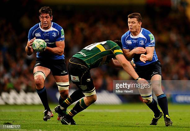 Nathan Hines of Leinster runs with the ball as Phil Dowson of Northampton tackles Brian O'Driscoll of Leinster during the Heineken Cup Final match...