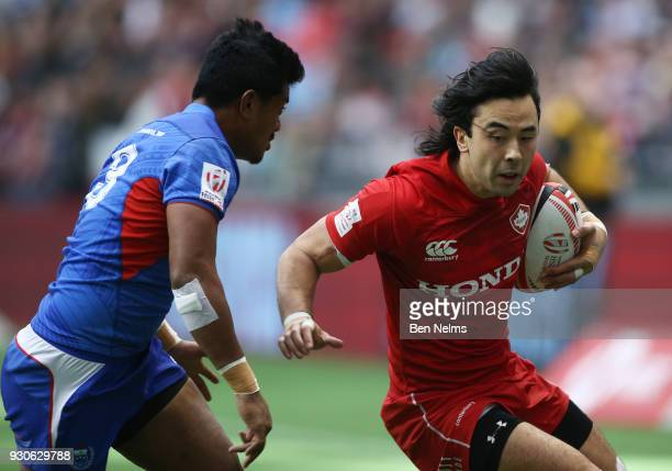 Nathan Hirayama of Canada runs the ball against Laaloi Leilua of Samoa during the Canada Sevens the Sixth round of the HSBC Sevens World Series at...