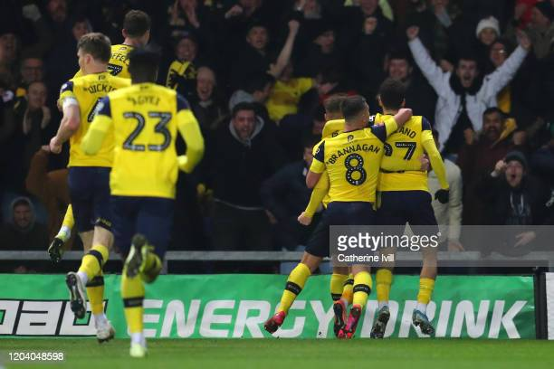 Nathan Holland of Oxford United celebrates with his team mates after scoring his team's second goal during the FA Cup Fourth Round Replay match...