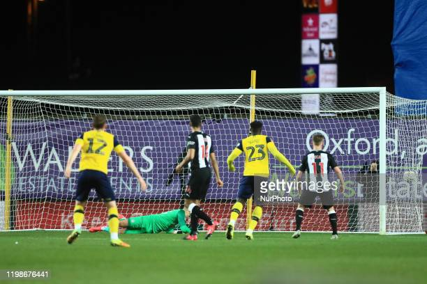 Nathan Holland of Oxford United scores his sides equalising goal during the FA Cup Fourth Round replay between Oxford United and Newcastle United at...