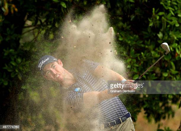 Nathan Holman of Australia plays a shot from the rough during day one of the 2015 Australian Masters at Huntingdale Golf Course on November 19, 2015...