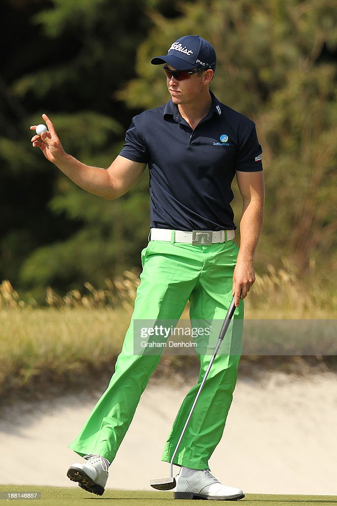 Nathan Holman of Australia waves to the crowd during round three of the 2013 Australian Masters at Royal Melbourne Golf Course on November 16, 2013 in Melbourne, Australia.