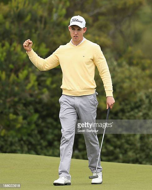 Nathan Holman of Victoria gestures after birdieing the 10th hole to take the lead during round two of the 2013 Australian Masters at Royal Melbourne...