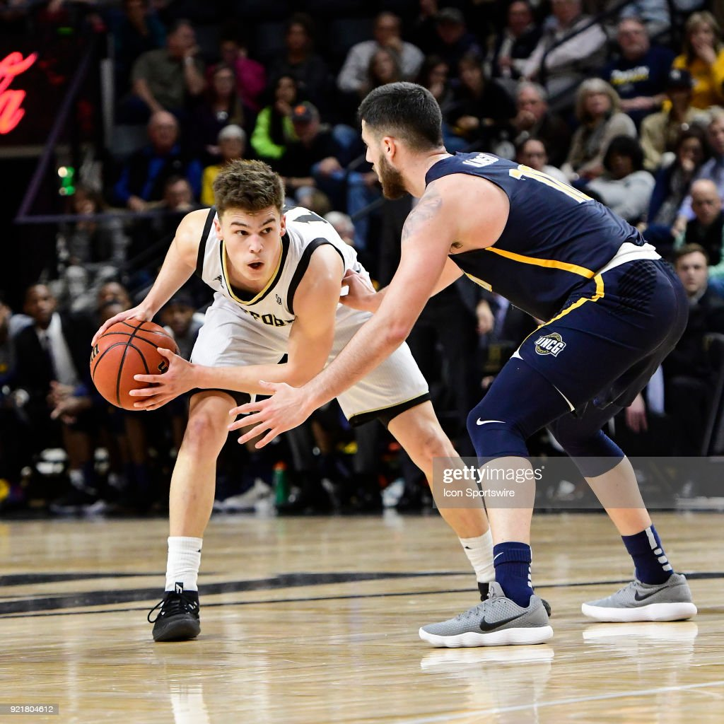 Nathan Hoover (10) guard Wofford College Terriers looks for a path around Demetrius Troy (11) guard University of North Carolina Greensboro (UNCG) Spartans, Tuesday, February 20, 2018, at Richardson Indoor Stadium in Spartanburg, South Carolina. UNC Greensboro wins 76-66.