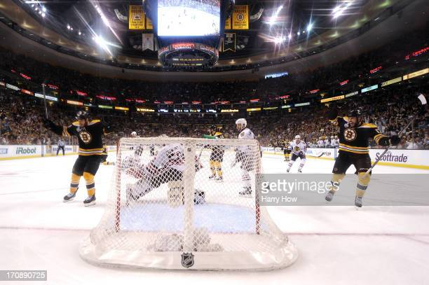 Nathan Horton and Milan Lucic of the Boston Bruins celebrate a goal by Johnny Boychuk against Corey Crawford of the Chicago Blackhawks in Game Four...