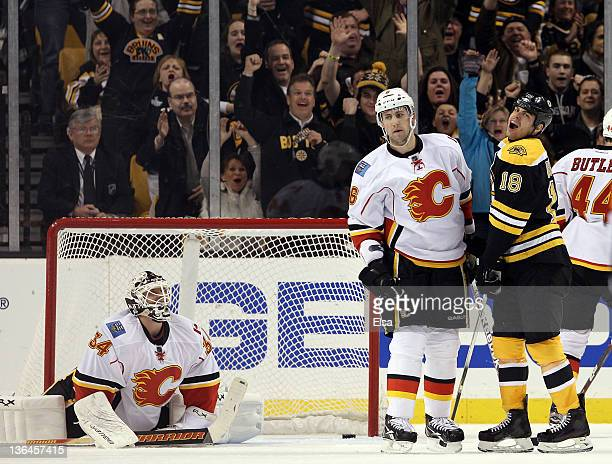 Nathan Horton of the Boston Bruins celebrates his goal in the second period as Miikka Kiprusoff and Cory Sarich of the Calgary Flames stand by on...