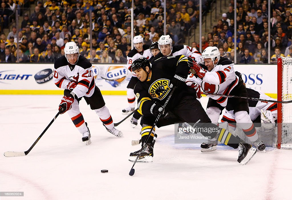 Nathan Horton #18 of the Boston Bruins skates with the puck against Andy Greene #6 of the New Jersey Devils during the game on January 29, 2013 at TD Garden in Boston, Massachusetts.