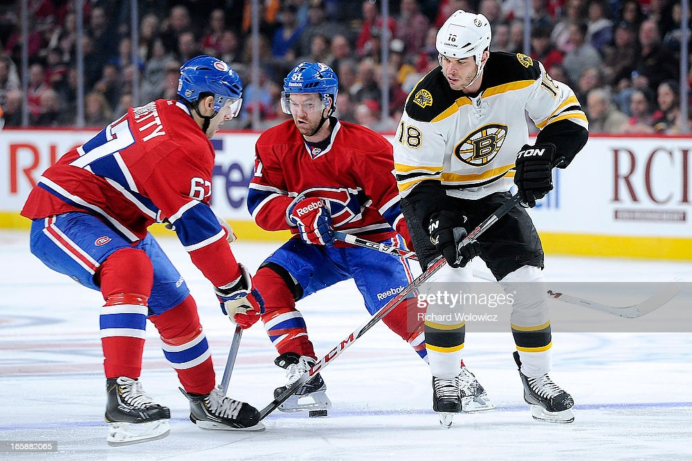 Nathan Horton #18 of the Boston Bruins strips the puck from Max Pacioretty #67 of the Montreal Canadiens during the NHL game at the Bell Centre on April 6, 2013 in Montreal, Quebec, Canada. The Canadiens defeated the Bruins 2-1.