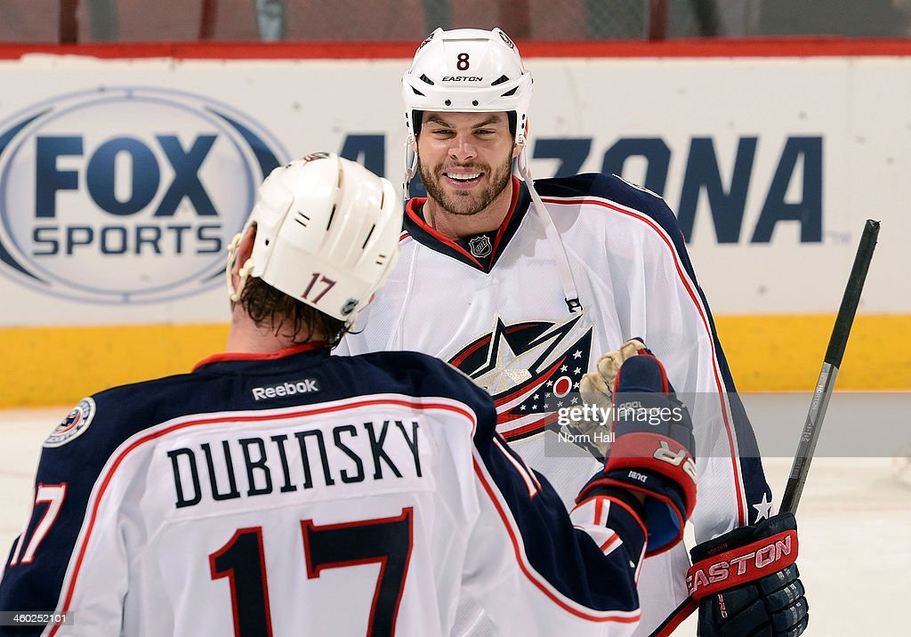 Nathan Horton #8 of the Columbus Blue Jackets is congratulated by teammate Brandon Dubinsky #17 after a 2-0 victory over the Phoenix Coyotes at Jobing.com Arena on January 2, 2014 in Glendale, Arizona.