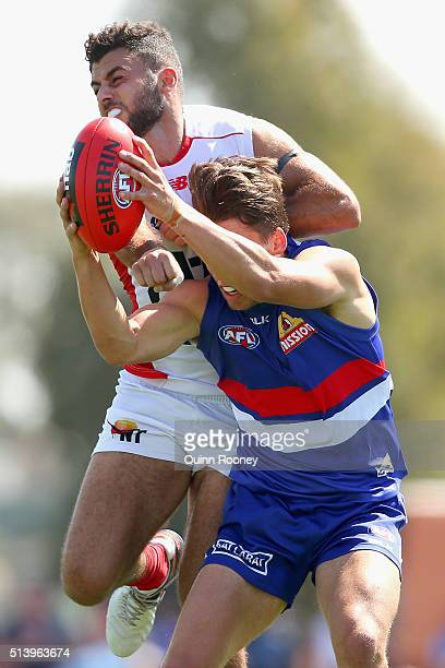 Nathan Hrovat of the Bulldogs marks infront Christian Salem of the Demons during the 2016 AFL NAB Challenge match between the Western Bulldogs and...