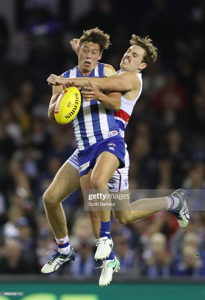 Nathan Hrovat of the Kangaroos and Zaine Cordy of the Bulldogs compete for the ball during the round four AFL match between the North Melbourne Kangaroos and the Western Bulldogs at Etihad Stadium on April 14, 2017 in Melbourne, Australia.
