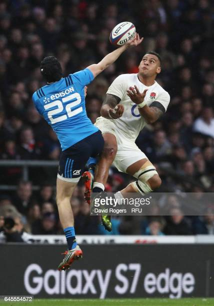 Nathan Hughes of England and Carlo Canna of Italy compete for a high ball during the RBS Six Nations match between England and Italy at Twickenham...