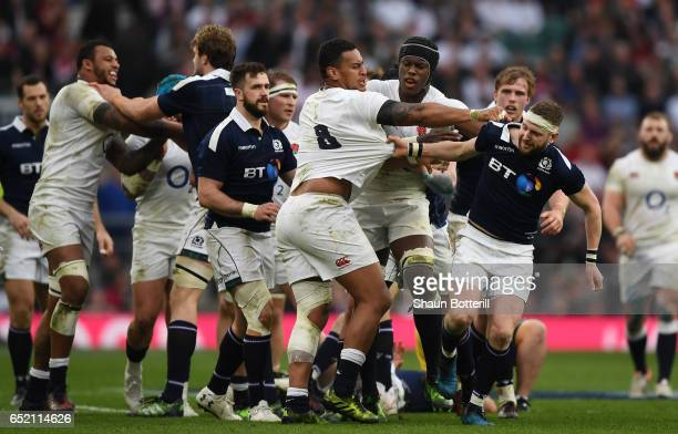Nathan Hughes of England and Finn Russell of Scotland confront each other during the RBS Six Nations match between England and Scotland at Twickenham...