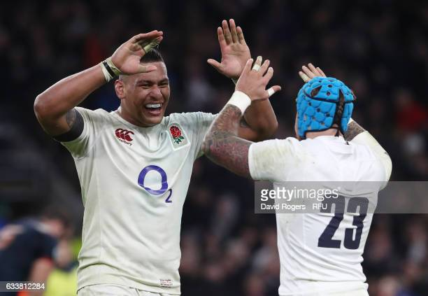 Nathan Hughes of England and Jack Nowell of England celebrate their team's victory after the final whistle blows during the RBS Six Nations match...