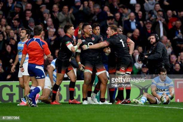 Nathan Hughes of England celebrates scoring his sides first try with his England team mates during the Old Mutual Wealth Series match between England...