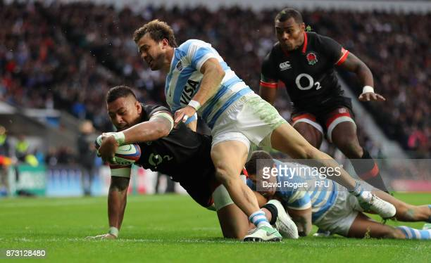 Nathan Hughes of England dives over for their first try during the Old Mutual Wealth Series international match between England and Argentina at...