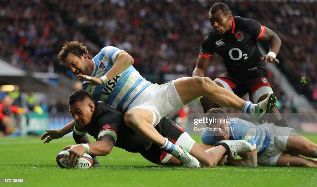Nathan Hughes of England dives over for their first try during the Old Mutual Wealth Series international match between England and Argentina at Twickenham Stadium on November 11, 2017 in London, England.
