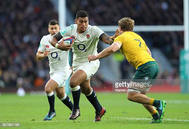 Nathan Hughes of England is challenged by Michael Hooper of Australia during the Old Mutual Wealth Series match between England and Australia at...