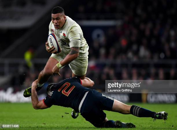 Nathan Hughes of England is tackled by Guilhem Guirado of France during the RBS Six Nations match between England and France at Twickenham Stadium on...