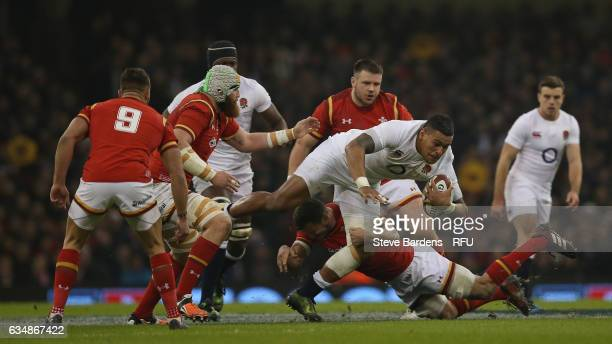 Nathan Hughes of England is tackled by Sam Warburton of Wales during the RBS Six Nations match between Wales and England at the Principality Stadium...