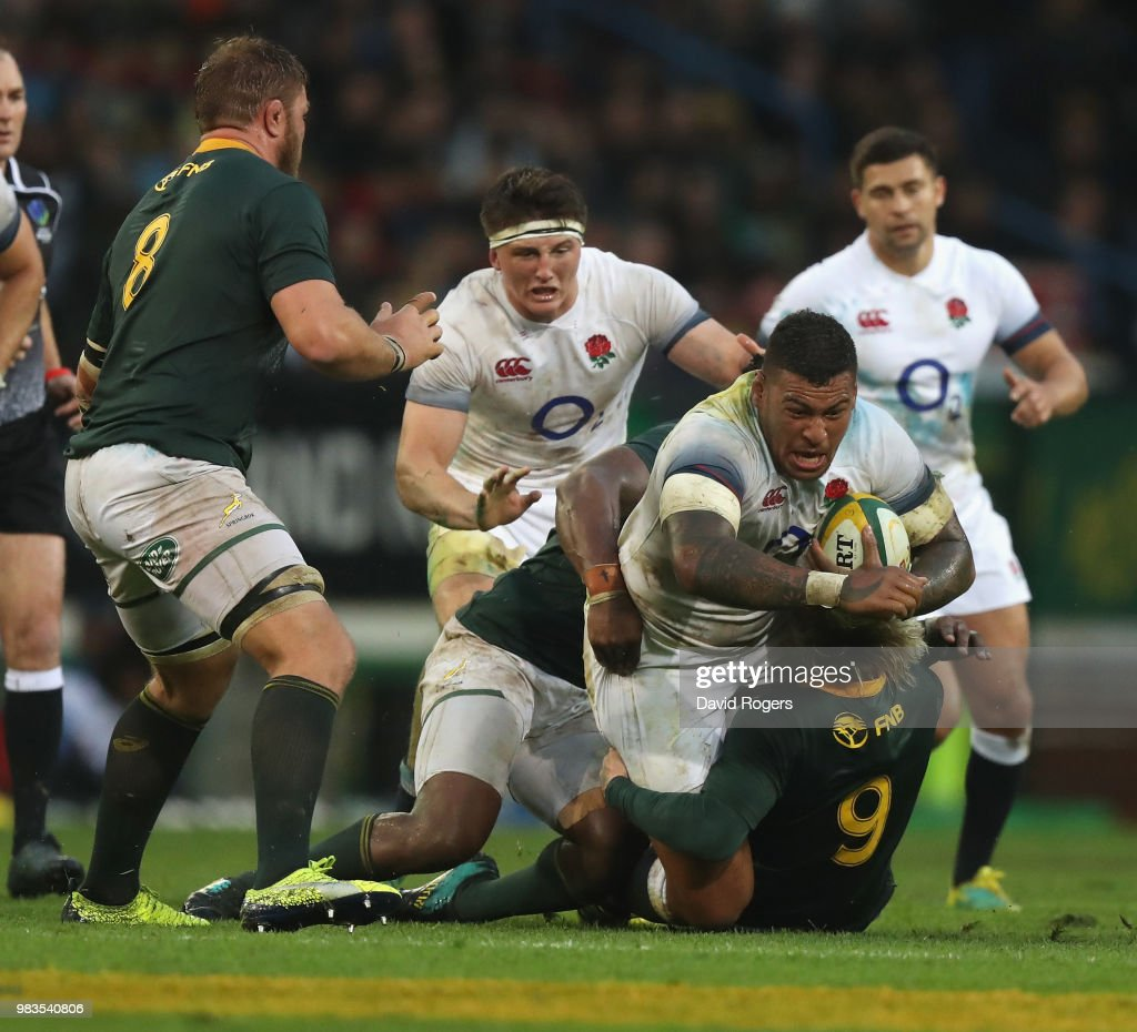 Nathan Hughes of England is tackled during the third test match between South Africa and England at Newlands Stadium on June 23, 2018 in Cape Town, South Africa.
