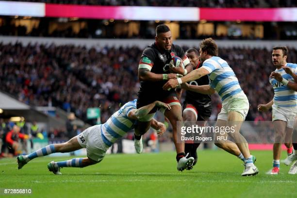 Nathan Hughes of England on the charge before scoring his sides first try during the Old Mutual Wealth Series match between England and Argentina at...