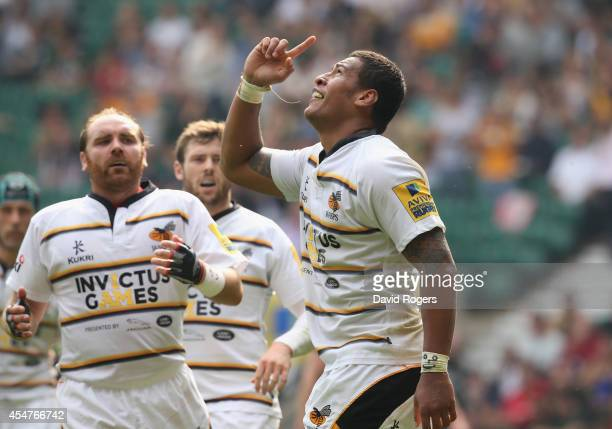 Nathan Hughes of Wasps celebrates after scoring a try during the Aviva Premiership match between Saracens and Wasps at Twickenham Stadium on...