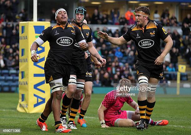 Nathan Hughes of Wasps celebrates after scoring his team's first try of the game during the Aviva Premiership match between Wasps and London Welsh at...