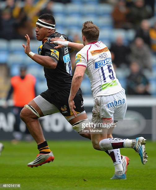Nathan Hughes of Wasps gets past Michael Haley of Sale Sharks on his way to scoring their second try during the Aviva Premiership match between Wasps...