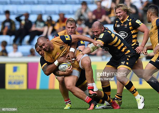 Nathan Hughes of Wasps tackles Jack Lam of Bristol Rugby during the Aviva Premiership match between Wasps and Bristol Rugby at The Ricoh Arena on...