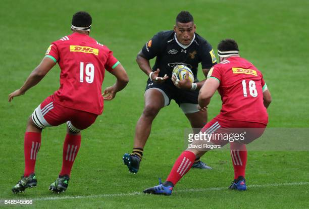 Nathan Hughes of Wasps takes on Ben Glynn and Will Collier during the Aviva Premiership match between Wasps and Harlequins at The Ricoh Arena on...