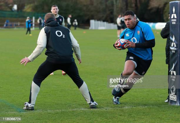 Nathan Hughes runs with the ball during the England training session held at Pennyhill Park on March 12 2019 in Bagshot England